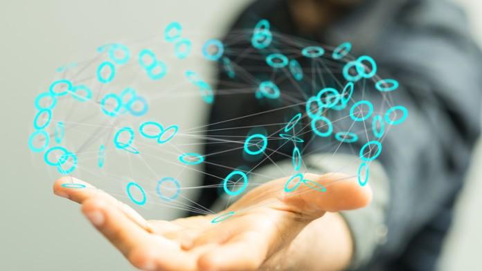 Hand über der ein virtuelles Netzwerk schwebt