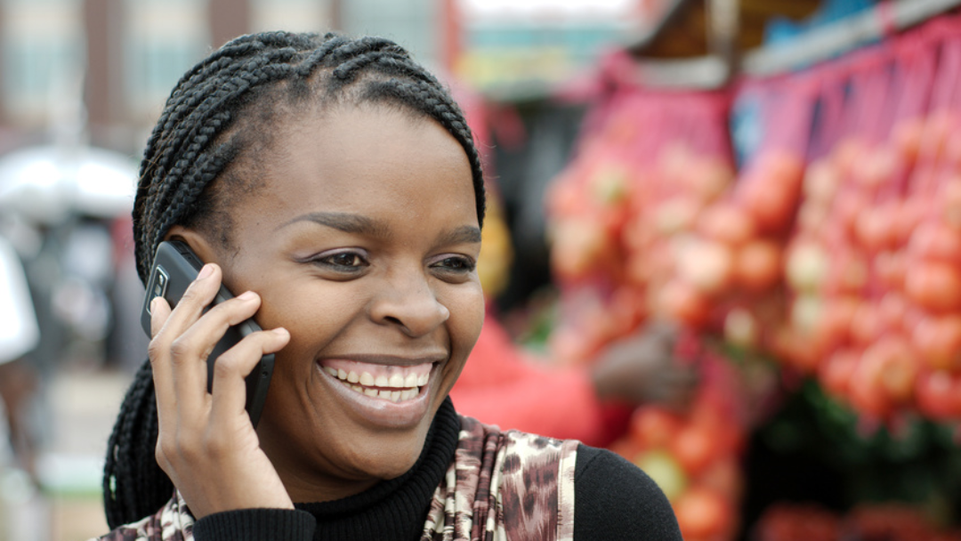 Young african woman with mobile phone.