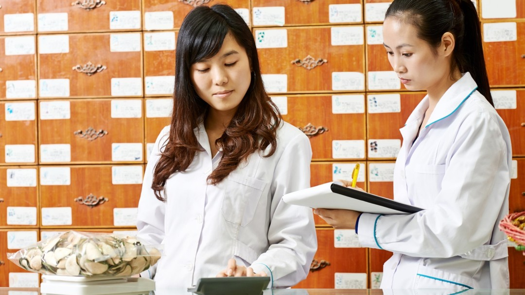 Two women working in a pharmacy