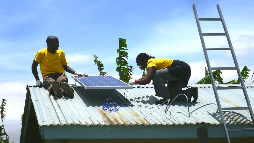 Technicians installing a photovoltaic plant on a rooftop